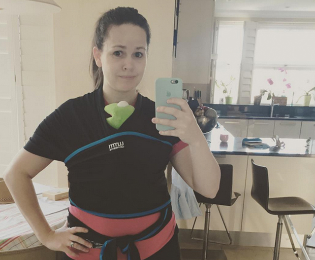 Giovanna needs help with her sling
