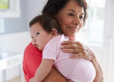 baby being cuddled by grandma