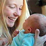 image of mum cuddling her baby