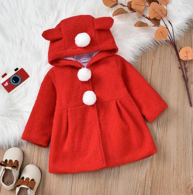 Red long sleeved hooded pom pom coat