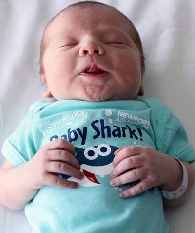 Baby in Baby Shark onesie