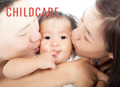 man and woman kissing childs cheeks