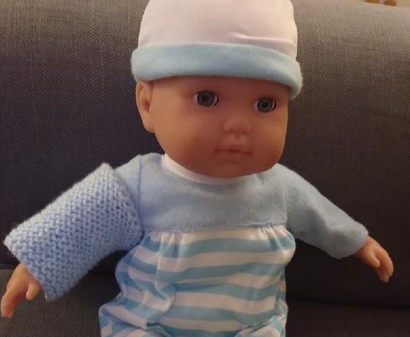 Doll with knitted sleeve