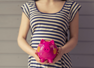 pregnant woman with piggy bank
