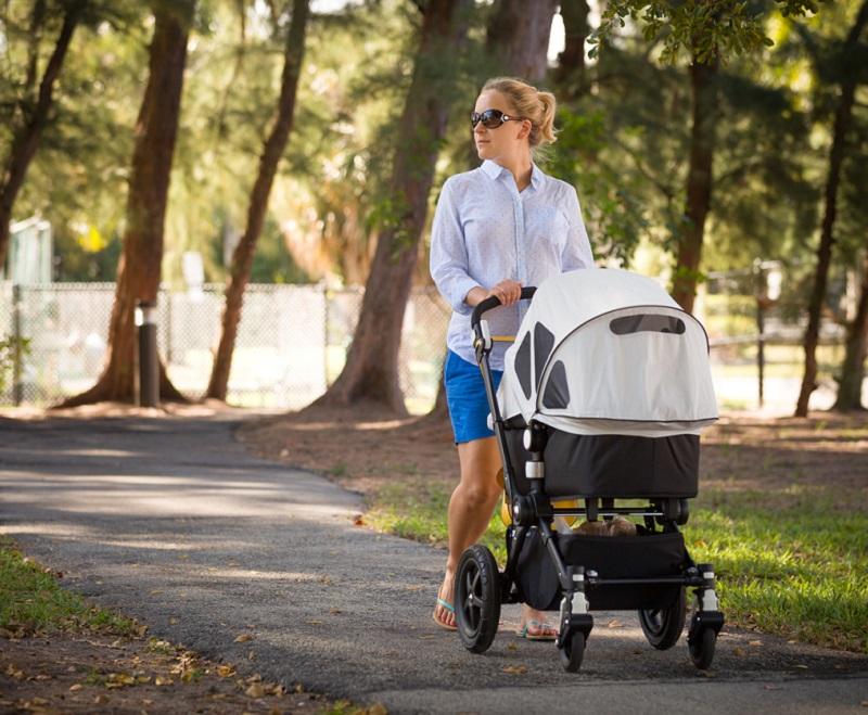 Mum walking with pram