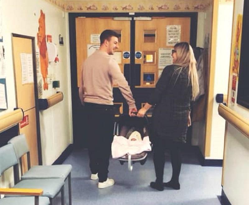 Proud parents leaving hospital