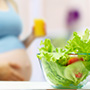 woman standing in front of salad bowl
