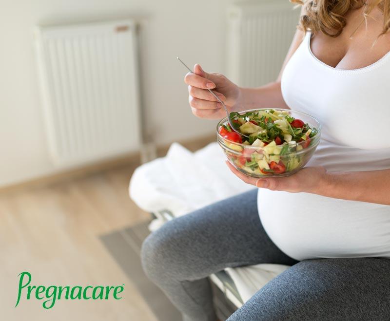 pregnant woman eating food