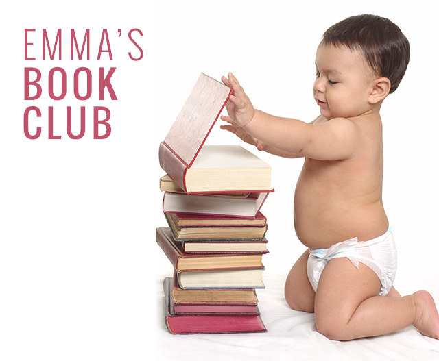 baby kneeling by books