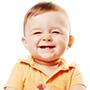 child sitting smiling