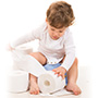 child sitting on potty with toilet roll